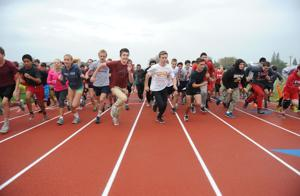 Lodi High School students shrug off rain during first run on new all-weather track