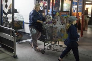 Lodi Shoppers Brave Black Friday Sales : A woman leaves Wal-Mart with a cart filled with childrens toys during the stores early Black Friday sale in Lodi on Thursday, Nov. 22, 2012.