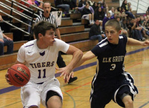 Boys basketball: Tigers edge Thundering Herd