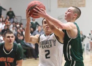 Boys basketball: Hawks too hot to handle