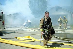 Blaze ignites two homes on Park West Drive; no one injured
