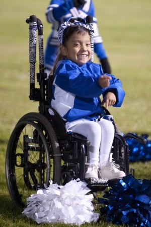 Not Even A Wheelchair Can Hold Back Lodi Youth Cheerleader: Lodi Colts cheerleader Katelyn Gauna, 5, practices cheers during at Salas Park in Lodi on Wednesday, Nov. 14, 2012.  - Photo by Ian Jonsson/News-Sentinel