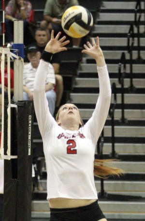 Kirstin Kielhold serves up 24 straight points as Flames ace Titans