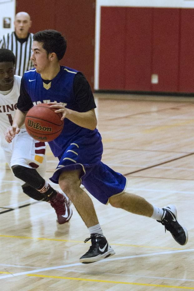 Boys basketball: Tigers end drought, return to playoffs with win over Vikings