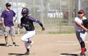 Softball: Tigers' bats overwhelm Flames