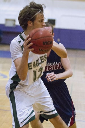 Boys basketball: Eagles soar over Falcons in playoff opener