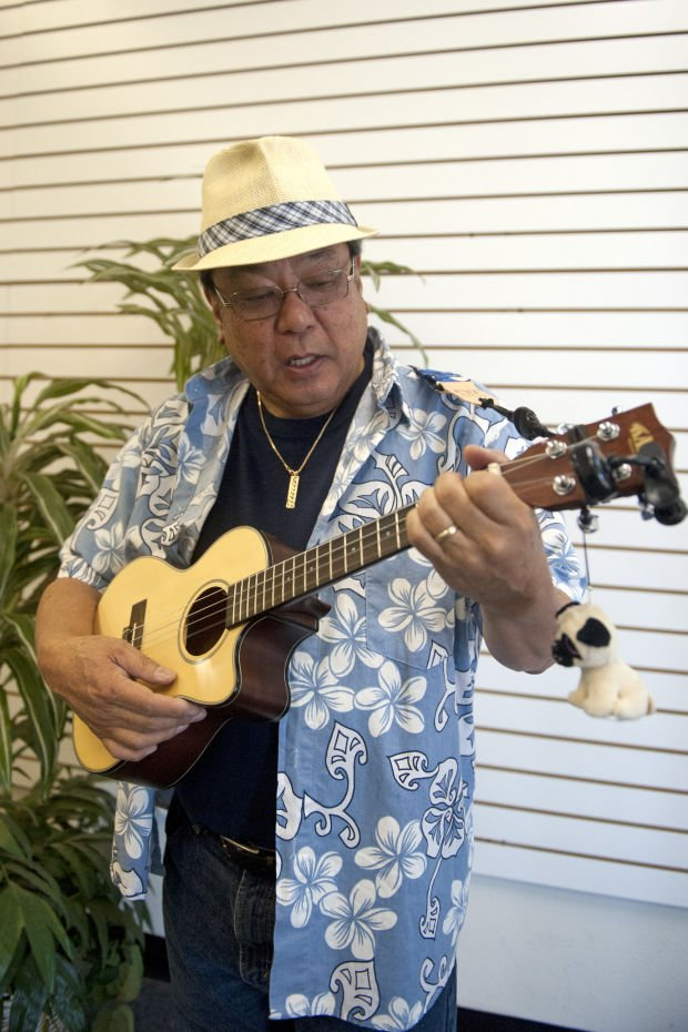Ukulele club member Dennis Yamamoto passes down joy to children