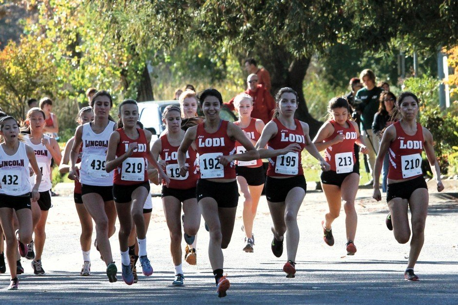 Tough road leads to title for Flames girls cross country team