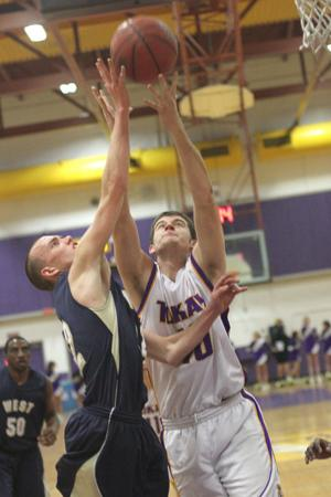 Boys basketball: Another close defeat drops Tigers to 0-2