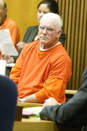 Alleged bank robber's trial delayed as both sides continue discovery