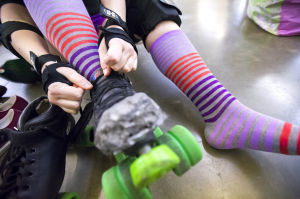 Reporter Skates After Her Derby Girl Dreams : News-Sentinel reporter Sara Jane Pohlman laces up her roller skate before practicing with the Port City Roller Girls roller derby team at the San Joaquin County Fairgrounds on Thursday, Feb. 7, 2013.  - Dan Evans/News-Sentinel