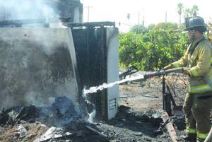 Abandoned house burns on Lower Sacramento Road