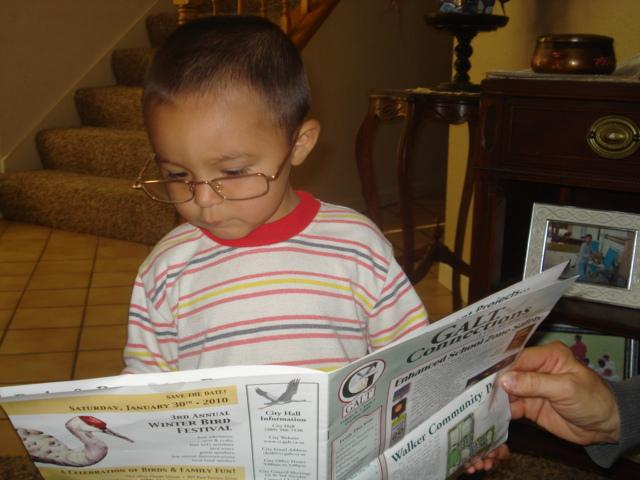 My Grandson David catching up on the news!