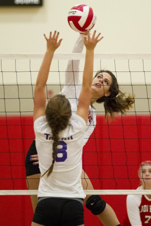 Big runs ignite the Flames over Tigers in varsity volleyball