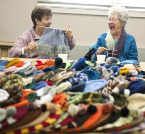 Local knitters, American Legion Auxiliary donate custom hats to veterans