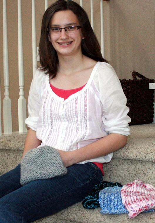Brianne Wild knits beanies for cancer patients