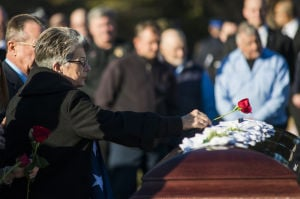 Fallen Galt Police Officer Kevin Tonn Laid To Rest : Maryann Tonn, Galt Police Officer Kevin Tonn's mother, places a rose on his casket during the graveside service on Monday, Jan. 21, 2013.  - Photo by Dan Evans/News-Sentinel