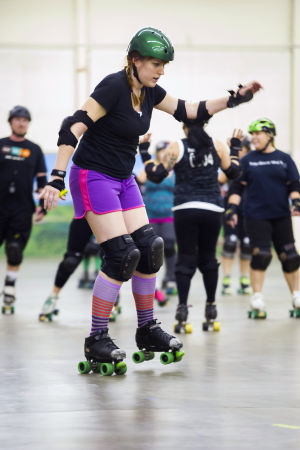 Reporter Skates After Her Derby Girl Dreams : News-Sentinel reporter Sara Jane Pohlman is unsteady on her skates as she slowly makes her way around the rink.  - Photo by Dan Evans/News-Sentinel