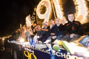 Parade Lights Up Lodi: St. Anne's Catholic School students wave from their float during the 17th annual Parade of Lights in Downtown Lodi on Thursday, Dec. 6, 2012.  - Dan Evans/News-Sentinel