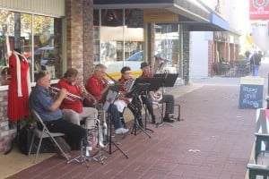 Lodi Shops Kickstart The Holiday Season: A five piece brass band belts out holiday tunes on School Street in Downtown Lodi on Saturday, Nov. 24, 2012. The holiday shopping season began with open houses at several stores.  - Photo by Sara Jane Pohlman/News-Sentinel