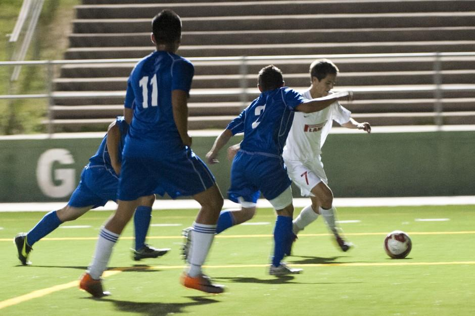 Flames hitting their stride as boys soccer playoff race heats up
