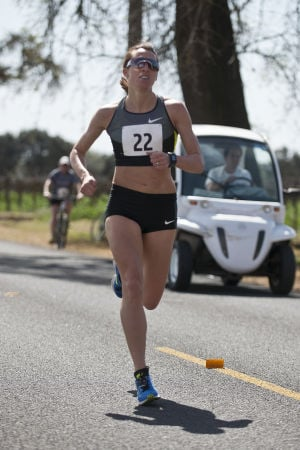 First-ever Lodi Mile Brings Cheerful Runners To Davis Road: Geena Gall, a 2012 U.S. Olympian in the 800 meter race, competes in Women's Elite race during the Lodi Mile on Saturday, March 16, 2013.  - Ian Jonsson/News-Sentinel