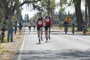 First-ever Lodi Mile Brings Cheerful Runners To Davis Road: Garrett Heath, left, and Peter Van Der Westhuizen race down Davis Road during the first Lodi Mile on Saturday, March 16, 2013.  - Photo by Ian Jonsson/News-Sentinel