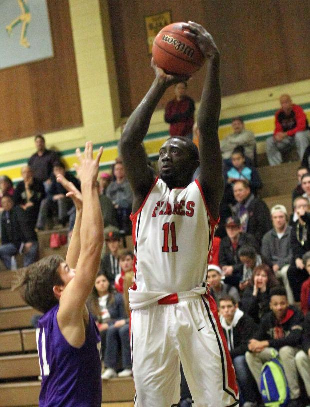 Boys basketball: Flames torch Tigers