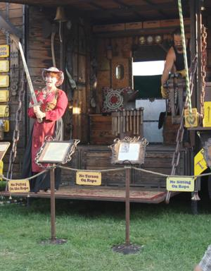 Happy gypsies visit Lodi Grape Festival; one a blacksmith, one a storyteller