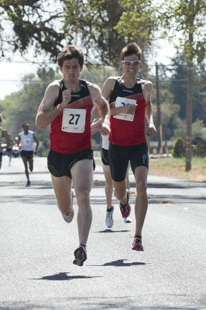 First-ever Lodi Mile Brings Cheerful Runners To Davis Road: Garrett Heath, left, and Peter Van Der Westhuizen fight for position during the first Lodi Mile on Saturday, March 16, 2013.  - Ian Jonsson/News-Sentinel