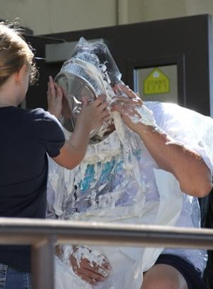 Woodbridge Elementary School principal John Kirilov takes pie to the face for fundraiser