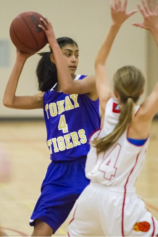 Girls basketball: Flames hold off Tigers' late charge in thrilling finish