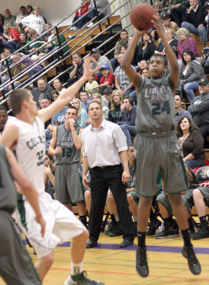 Boys Basketball: Hawks Outlast Falcons In Overtime, Advance To Section Championship : Liberty Ranch Hawks varsity boys basketball coach Josh Williams, center, watches as DeAndre Stallings shoots and scores on one of his six three-point baskets against the Colfax Falcons at Tokay High School on Wednesday, Feb. 27, 2013. The Hawks beat the Falcons 64-59 in overtime to advance to the Sac-Joaquin Section Division IV championship against the Summerville Bears of Tuolumne at Sleep Train Arena in Sacramento on Saturday, March 2, 2013.