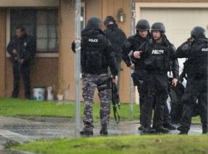 Suspect In Galt Animal Control Shooting Arrested: Sacramento Police SWAT team members gather near a crime scene where a Sacramento Animal Control officer was fatally shot through the door of a residence Wednesday, Nov. 28, 2012 in Galt.  - Photo by AP Photo/The Sacramento Bee, Randy Pench