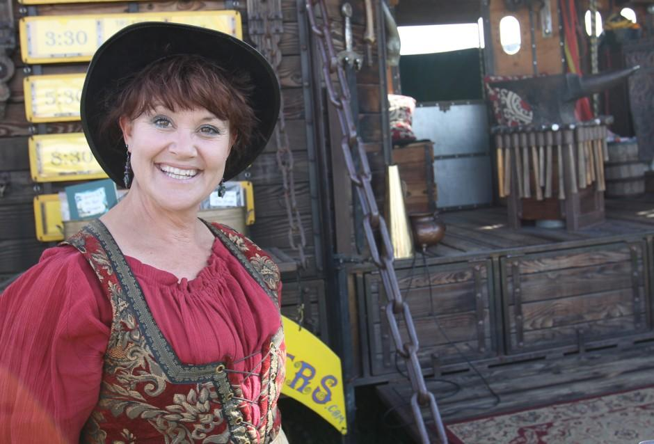 Happy gypsies visit Lodi Grape Festival; one a blacksmith, one a storyteller