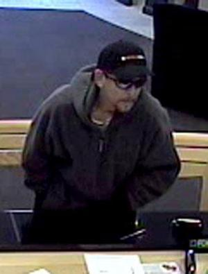 Police release photos of suspected bank robber