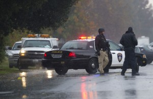 Suspect In Galt Animal Control Shooting Arrested: Law enforcement officers surround a crime scene where a Sacramento Animal Control officer was fatally shot through the door of a residence, Wednesday, Nov. 28, 2012, in Galt.  - Photo by AP Photo/The Sacramento Bee, Randy Pench