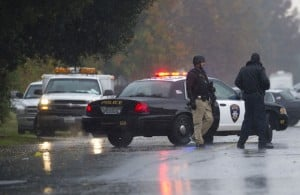 Suspect In Galt Animal Control Shooting Arrested: Law enforcement officers surround a crime scene where a Sacramento Animal Control officer was fatally shot through the door of a residence, Wednesday, Nov. 28, 2012, in Galt.  - AP Photo/The Sacramento Bee, Randy Pench