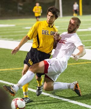 Flames rise to victory in varsity boys soccer playoff opener