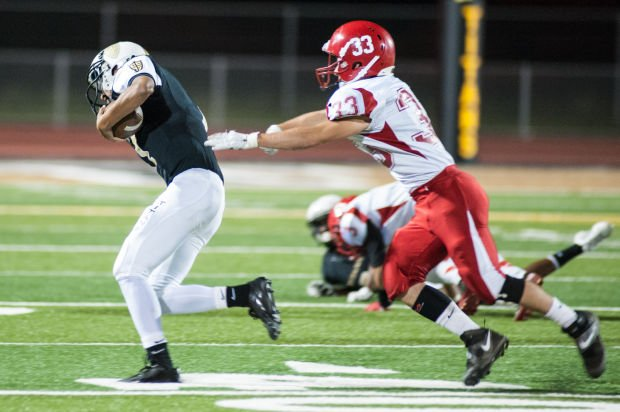 Football: Flames hold off Titans in league opener