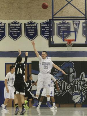 Boys basketball: Eagles fall to Knights in first-place showdown