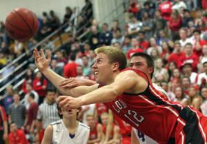 Boys basketball: Flames bring the heat in win over Tigers