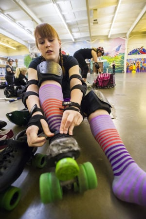 Reporter Skates After Her Derby Girl Dreams : News-Sentinel reporter Sara Jane Pohlman secures her skates before practicing with the Port City Roller Girls roller derby team at the San Joaquin County Fairgrounds on Thursday, Feb. 7, 2013.  - Dan Evans/News-Sentinel