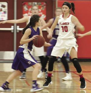 Girls basketball: Timely shots, opportunistic defense carry Flames over Tigers