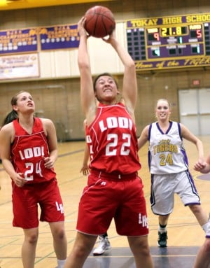 Jill Burkhard helps spark the Lodi Flames in girls basketball