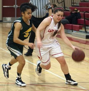 Girls basketball: Flames let large lead slip away, remain winless in league play