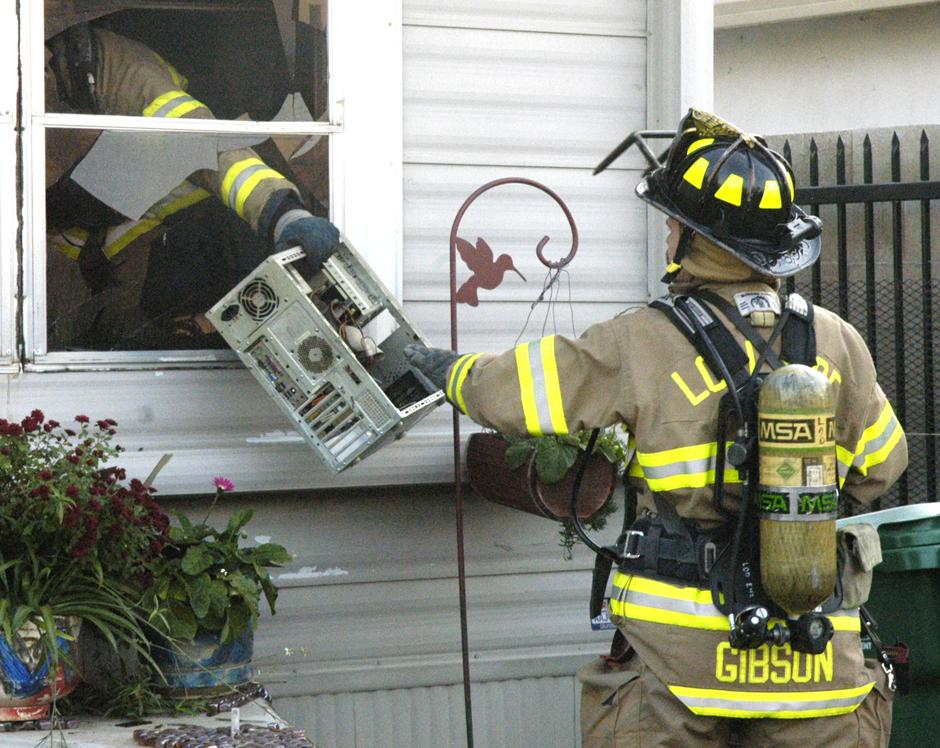 Mobile home goes up in flames; dog perishes