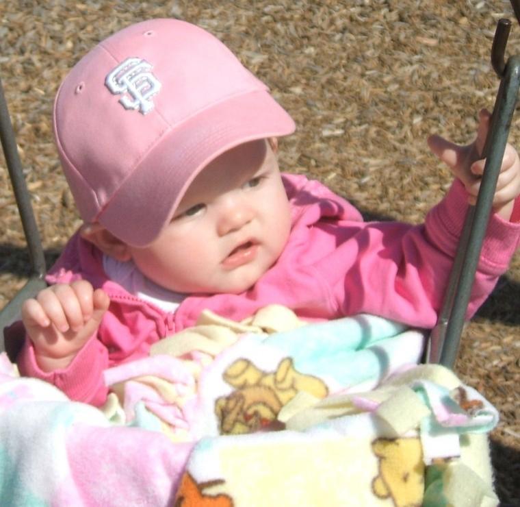 Enjoying the swings at Henry Glaves Park