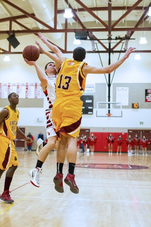 Boys basketball: Flames fend off Bulldogs