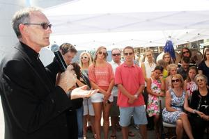 St. Anne's Catholic Church priests bless grapes in memory of John Van Ruiten Sr.